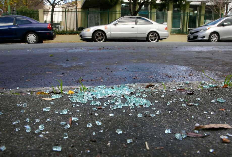 Car glass litters the sidewalk along 23rd st. in the Mission neighborhood in San Francisco, Calif., as seen on Thursday Jan. 25, 2018.�A new report shows that of the more than 81,000 online reports of car burglaries in San Francisco in the past 7 years only 13 people were arrested for the crime. Photo: Michael Macor / The Chronicle