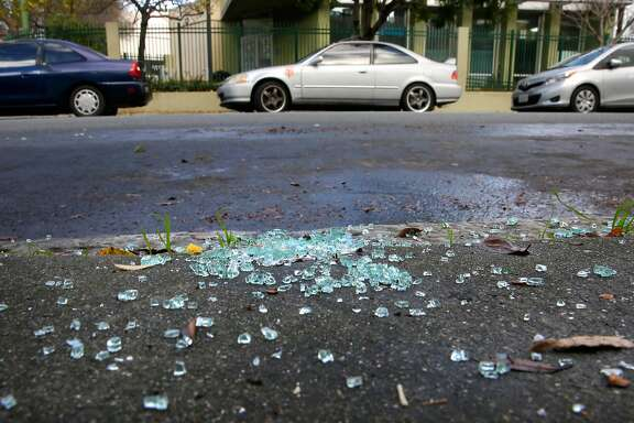 Car glass litters the sidewalk along 23rd st. in the Mission neighborhood in San Francisco, Calif., as seen on Thursday Jan. 25, 2018. A new report shows that of the 82 thousand car burglaries only 13 people were arrested for the crime.
