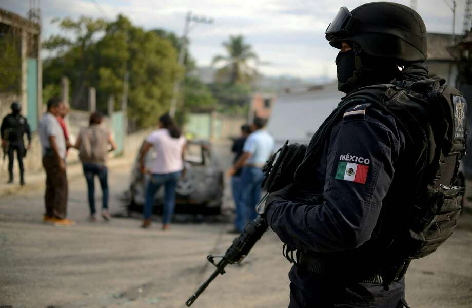 File photo of a Mexican police officer near the scene of another violent killing Jan. 25, 2018.  Nearly 19,000 people have been killed due to organized crime in Mexico in 2017, the most violent year in twenty years, according to a report revealed Tuesday by the Mexican NGO Semaforo Delictivo. Photo: FRANCISCO ROBLES, AFP/Getty Images