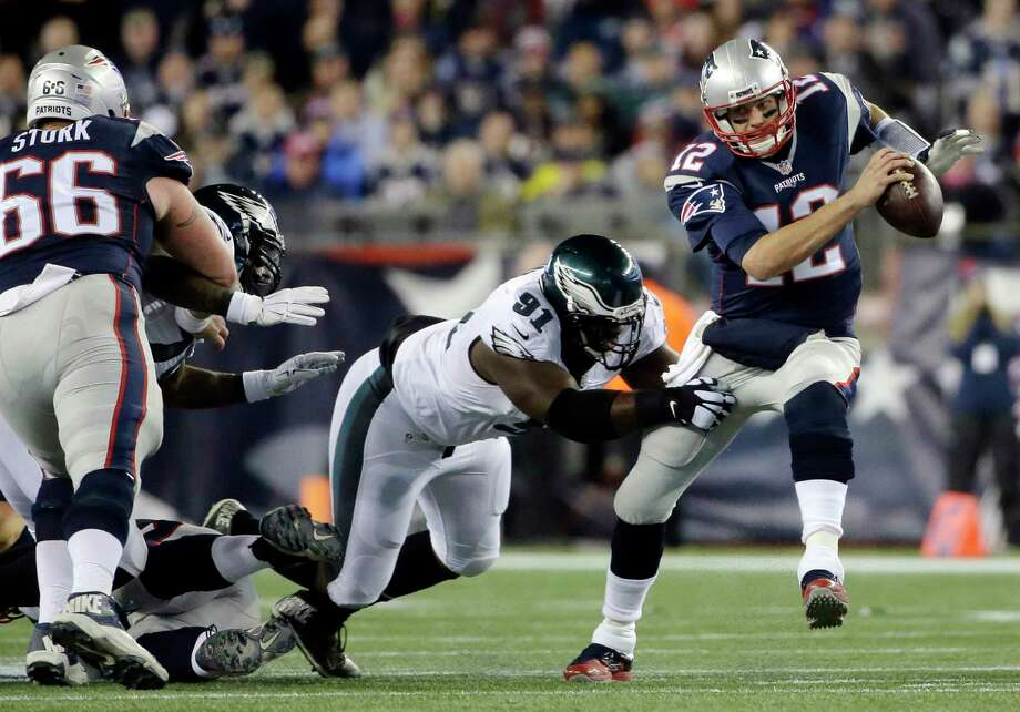 FILE- In this Dec. 6, 2015, file photo, New England Patriots quarterback Tom Brady (12) scrambles away from Philadelphia Eagles defensive end Fletcher Cox (91) during the first half of an NFL football in Foxborough, Mass. Cox, Malcolm Jenkins, Brandon Graham, Vinny Curry, Mychal Kendricks and Beau Allen are six key defensive players left from an Eagles team that beat Tom Brady and the Patriots 35-28 in Foxborough in December 2015 (AP Photo/Steven Senne, File) Photo: Steven Senne, STF / Copyright 2018 The Associated Press. All rights reserved.