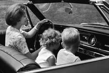 """2) Crummy Car Seats and Seat Belts     Little kids would sit in the passenger seat without a seatbelt. The """"safety method"""" was this: Mom or Dad would fling an arm in front of you if they had to stop short. Infants rode sometimes in unattached baby seats. They were kept up front in the seat next to Mom—or in someone's lap! Bigger babies or toddlers rodein in shoddy car seats. Seat belts just went across the lap. Serious seat belts and appropriate  car seat regulations  did not arrive  until the '70s  and airbags in the '80s."""