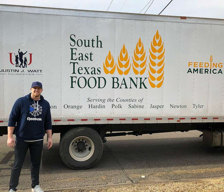 Texans defensive lineman J.J. Watt poses in front of a new Southeast Texas Food Bank truck during a visit to Port Arthur on Jan. 25, 2018. (Twitter Photo)