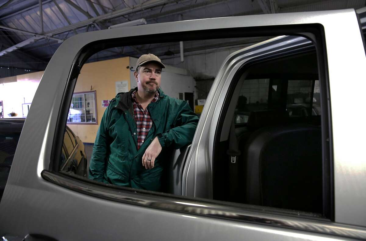 Kirk Schwyn visiting from Jackson, Calif., today when his vehicle was broken into down by the Marina and over $4,500.00 in electronics were stolen after his rear side window was smashed as seen on Thursday Jan. 25, 2018, San Francisco, Calif. He is waiting at Auto Glass Now San Francisco waiting for replacement glass. A new report shows that of the 82,000 car burglaries in San Francisco, only 13 people were arrested for the crime.