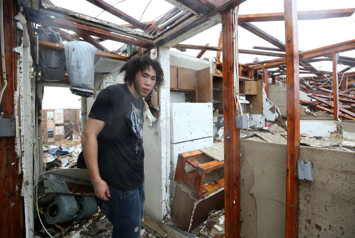 Nathan Kaufman looks around the remains of his Harvey-devastated home Saturday, Aug. 26, 2017 at the Salt Grass Landing Apartments complex in Rockport.