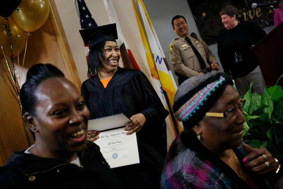 La Carla Carr (center) holds her diploma after posing for a photo with her aunt Synithia King (left) and grandmother Sallie Newell (right)  after the winter class of 2018  Five Keys Schools and programs  graduation ceremony at the Hall of Justice on Thursday, January 25, 2018 in San Francisco, Calif. Photo: Lea Suzuki, The Chronicle