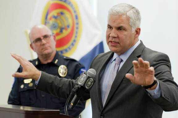 Montgomery County District Attorney Brett Ligon speaks beside Conroe Police Chief Philip Dupuis during a press conference at the Conroe Police Department, Thursday, Jan. 25, 2018, in Conroe. An FBI agent shot and killed a Montgomery County kidnapping victim during a predawn FBI operation in northeast Houston on Thursday morning. The father was taken from his Conroe home Wednesday when a pair of men claiming cartel connections forced their way into a home and bound the father and son inside.