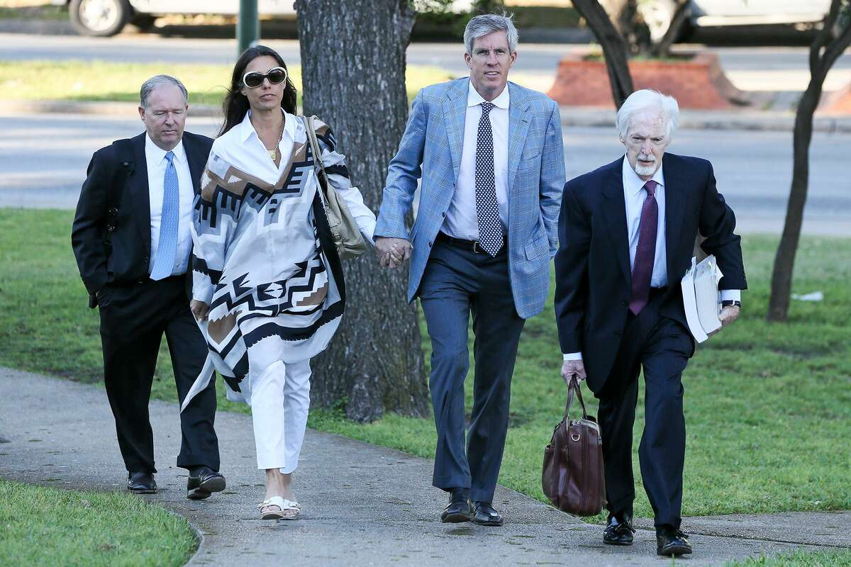 Charles A. Banks IV (second from right) arrives at the federal courthouse with his wife, Ali Banks and defense attorneys John Murphy (right) and Johnny Sutton on Monday, April 3, 2017, where he plead guilty to wire fraud in defrauding retired Spurs star Tim Duncan in a $7.5 million loan-investment deal. MARVIN PFEIFFER/ mpfeiffer@express-news.net
