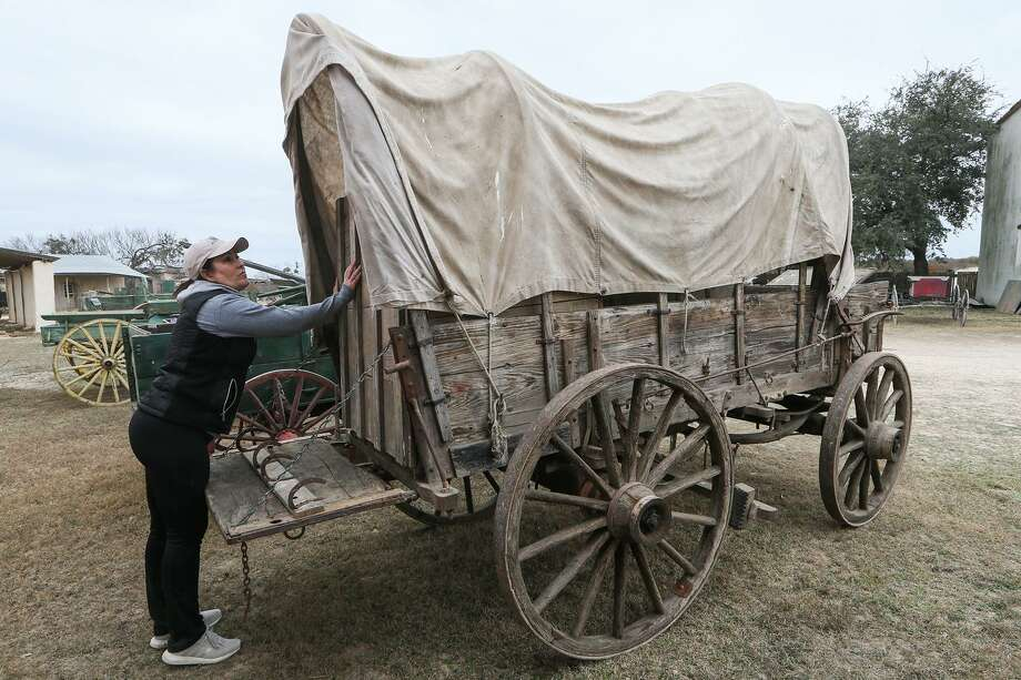 "Joanie Sellars Edwards, owner of The Nest Estate Sale Services, inspects a chuckwagon listed for $9,900 at the Alamo Village near Brackettville on Jan. 25, 2018. About 2,400 items will be sold this weekend from the movie set, where 72 motion pictures were filmed since the early 1950s, including ""The Alamo"" in 1959. Photo: Marvin Pfeiffer /San Antonio Express-News / Express-News 2018"