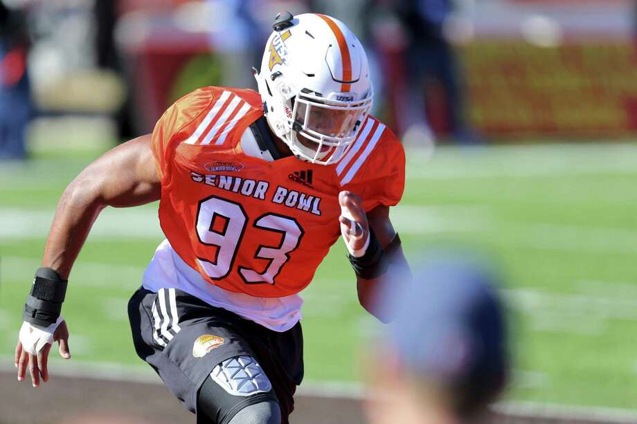 FILE - In this Tuesday, Jan. 23, 2018, file photo, South Squad defensive end Marcus Davenport, of UTSA, runs drills during the South's practice in Mobile, Ala., for Saturday's Senior Bowl NCAA college football game. The 6-foot-6, 259-pounder is one of the top NFL prospects at the Senior Bowl this week, rated as a potential first-rounder and maybe even a Top 10 pick. (AP Photo/Butch Dill) Photo: Butch Dill, FRE / Associated Press / FR111446 AP