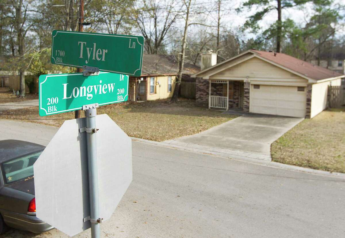 A father and son were Police were bound by a pair of men on Wednesday claiming cartel connections is seen on Tyler Lane, Thursday, Jan. 25, 2018, in Conroe. The father was taken away by the kidnappers and later killed Thursday morning during an FBI raid.