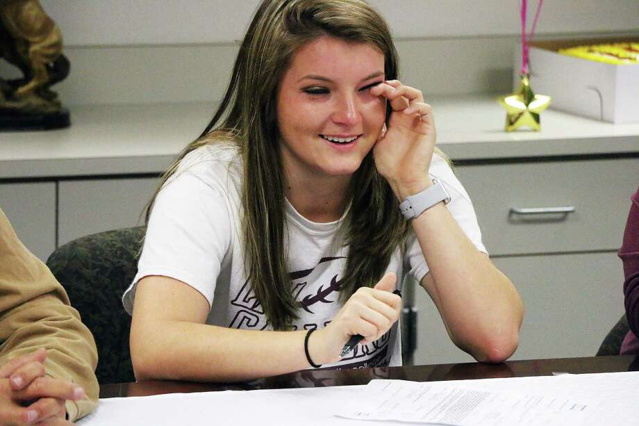 Hailey Pence wipes tears from her eyes as she takes time to thank her parents, friends, and coaches for helping her get where she is today. The Dayton High School senior signed a Letter of National Intent to play softball at Bossier Parish Community College in Louisiana. Photo: David Taylor