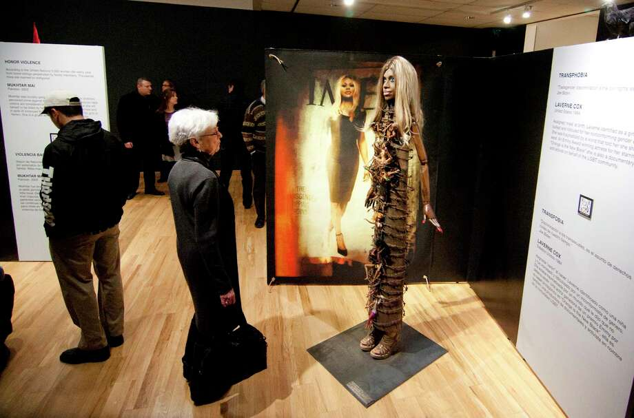 "Paula Cantor, of Woodcliff Lake, NJ, and friend of artist Ann Weiner, looks at one of eight sculptures on display during an opening reception exhibit entitled ""When Caged Birds Sing"" by Weiner held at Housatonic Museum of Art at Housatonic Community College in Bridgeport, Conn., Jan. 25, 2018. The exhibition shares the real-life stories of eight courageous women who each endured, and survived, abuse that is rarely discussed openly. Through assemblage art, Weiner thrusts domestic abuse, sex trafficking, date rape, kidnapping, transphobia, female genital mutilation, honor killings, the denial of educational opportunities and the sale of child brides into the spotlight. Photo: Christian Abraham, Hearst Connecticut Media / Connecticut Post"