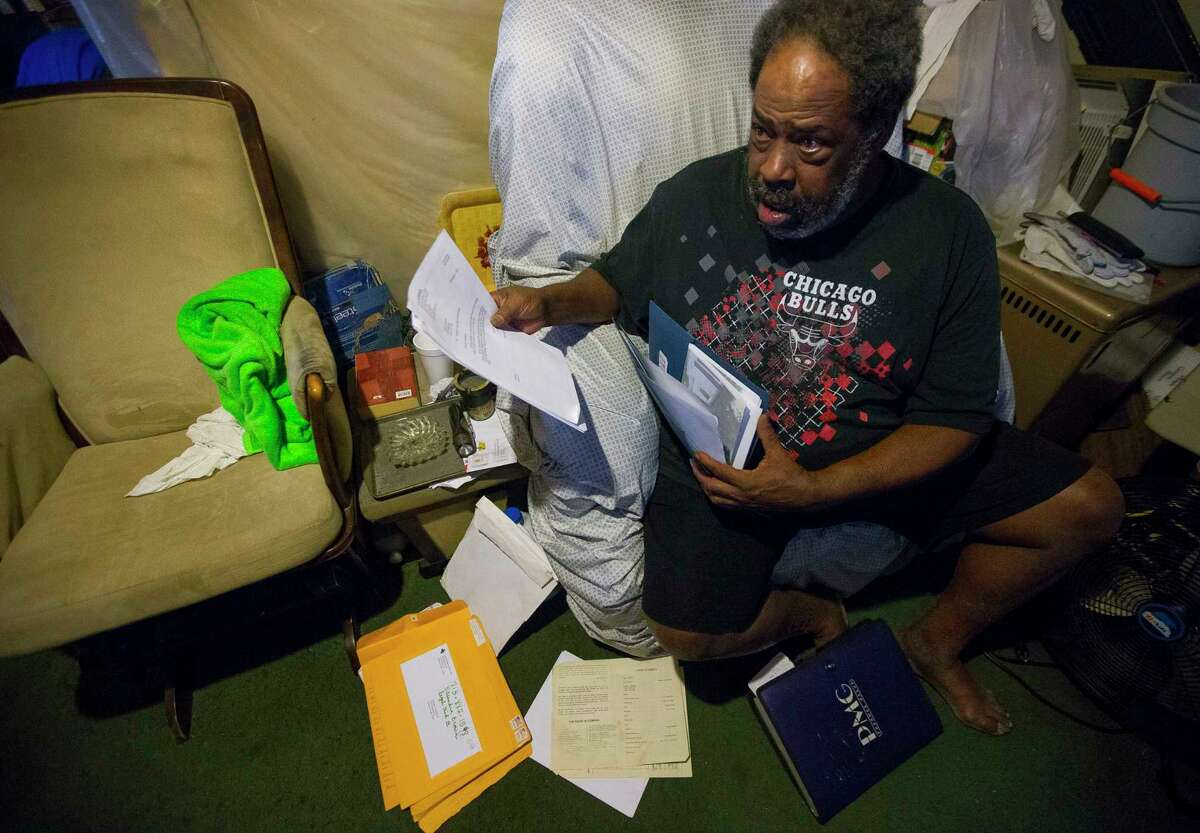 Herman Smallwood sorts through papers in his Aldine home, Thursday, Jan. 11, 2018. Smallwood was denied assistance from FEMA to repair his home after Hurricane Harvey. ( Mark Mulligan / Houston Chronicle )