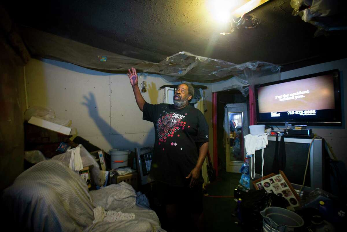 Herman Smallwood gestures to the sinking ceiling of his Aldine home, Thursday, Jan. 11, 2018. Smallwood was denied assistance from FEMA to repair his home after Hurricane Harvey. ( Mark Mulligan / Houston Chronicle )