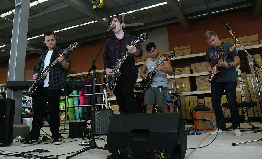 Lives of Nick band members J.D. Schultze, from left, Caymen Mann, Eric Torres, and Austin Flematti, plus Garrett Huber, not pictured, all students at Kingwood High School, perform during the benefit concert for Kingwood High School music departments held at Kingwood HEB on Jan. 20, 2018. (Photo by Jerry Baker/Freelance) Photo: Jerry Baker, Freelance / Freelance