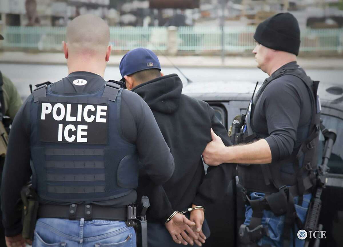 Immigration and Customs Enforcement officers detain a suspect during an enforcement operation on Feb. 7, 2017 in Los Angeles.