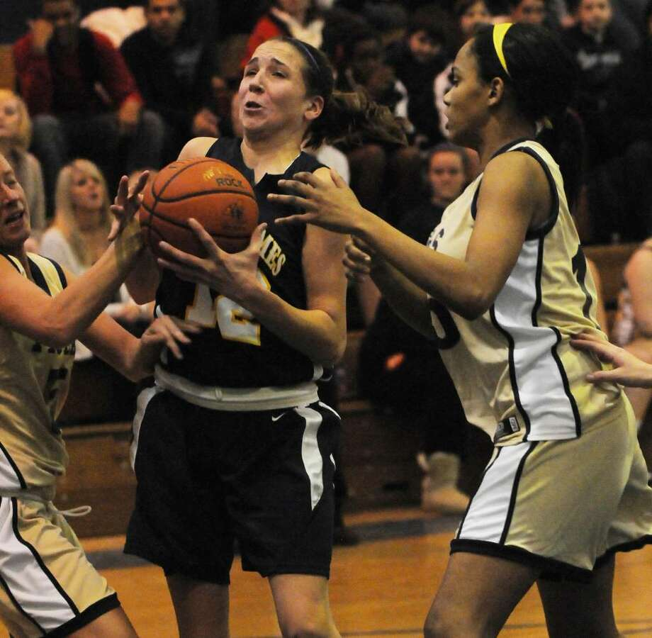 Sara Agan of Holy Names, center, fights for a loose ball with Cohoes' Laura Rankin, right. (Luanne  M. Ferris / Times Union) Photo: LMF