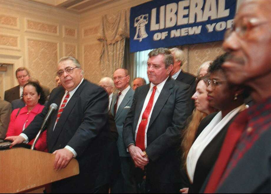 Raymond B. Harding, third from left, acted as a Liberal Party powerbroker. He pleaded guilty to securities fraud for stealing $800,000 from the state pension fund. In this 1998 archive photo, Harding, then vice chairman of the Liberal Party is surrounded by other party officials at a news conference in New York where he announced his third-party line support for  Lt. Gov. Betsy McCaughey Ross in her uphill bid to unseat former running mate George Pataki in that year's race for governor.  (AP Photo/archive) Photo: SUSAN PLUNKETT / AP
