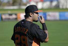 San Francisco Giants' Hector Sanchez prepares for a spring training baseball workout Wednesday, Feb. 13, 2013, in Scottsdale, Ariz. (AP Photo/Darron Cummings)