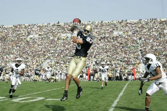 SOUTH BEND, IN - SEPTEMBER 9:  Jeff Samardzija #83 of the Notre Dame Fighting Irish makes a catch against the Penn State Nittany Lions at Notre Dame Stadium on September 9, 2006 in South Bend, Indiana. The Irish defeated the Nittany Lions 41-17. (Photo by Joe Robbins/Getty Images)