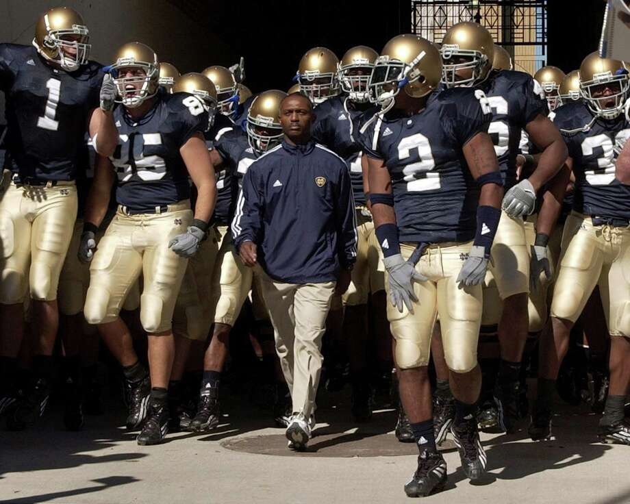 Notre Dame Coach Tyrone Willingham walks down the tunnel to the field with his team in before the game in Purdue's 41-16 win over Notre Dame in Notre Dame Stadium, South Bend, IN 10-2-04. (Photo by Sandra Dukes/Getty Images) Photo: Sandra Dukes / Getty Images / This content is subject to copyright.