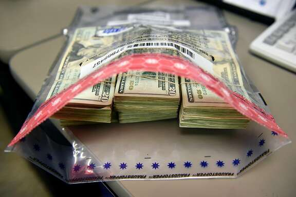 A marijuana business owner's cash tax payment is separated in to $18,000.00 deposits bags at the California Department of Tax and Fee Administration in Oakland, CA, on Monday November 27, 2017.