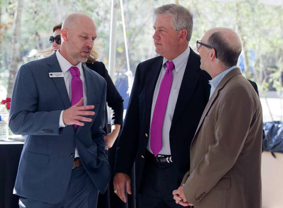 Montgomery County Judge Craig Doyal, center, talks with Willis ISD Superintendent Tim Harkrider, left, beside Brian Bondy, president of the Lake Conroe/Conroe Chamber of Commerce, during a ground breaking ceremony for The Woodlands Hills master-planned community, Wednesday, Nov. 15, 2017, in North Montgomery County. The new development with include 4,500 homes over 2,000 acres with more than 20 parks and other green spaces. Photo: Jason Fochtman, Staff Photographer / © 2017 Houston Chronicle