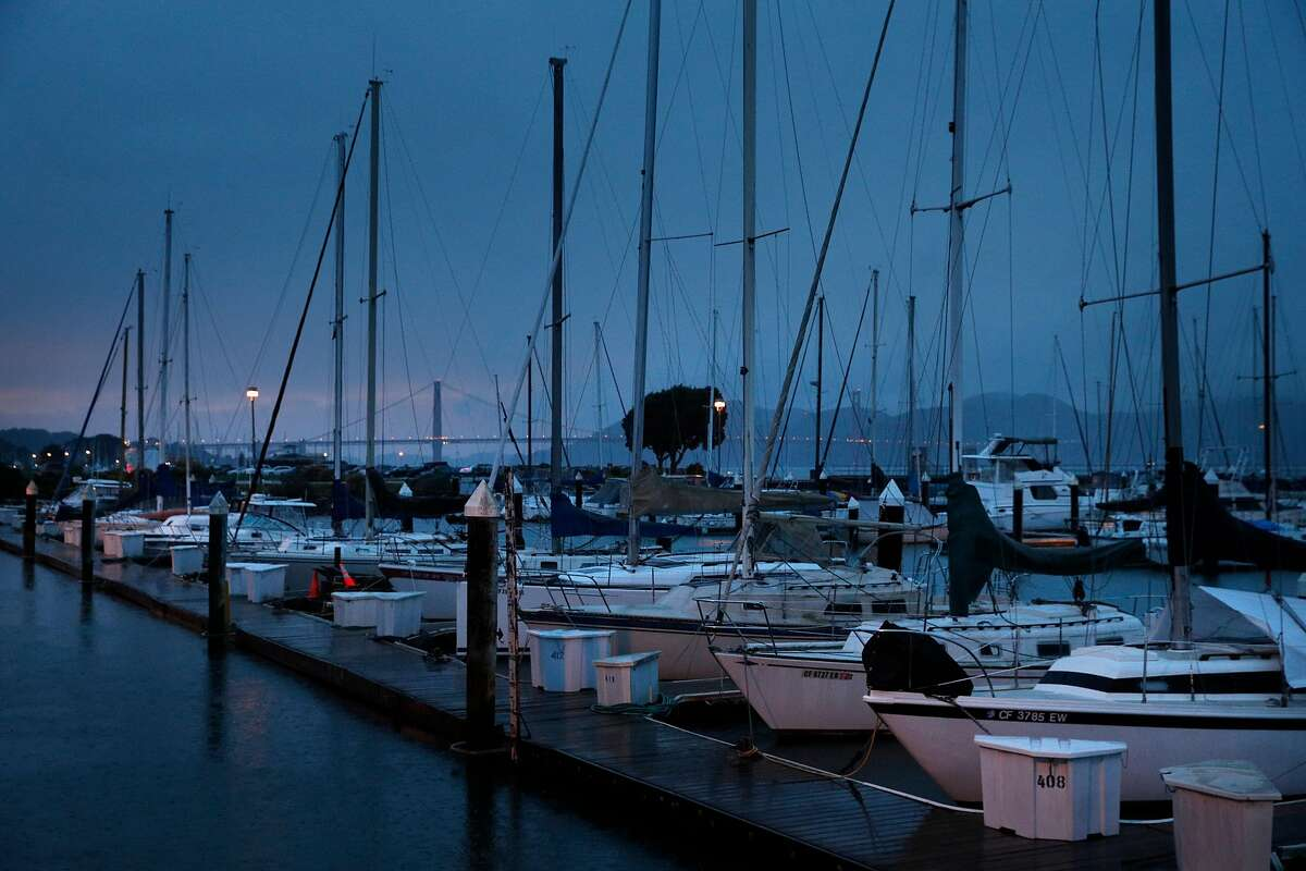 The Golden Gate Bridge is seen beyond docked boats at the East Harbor Marina near Fort Mason in San Francisco, Calif., on Wednesday, January 24, 2018.