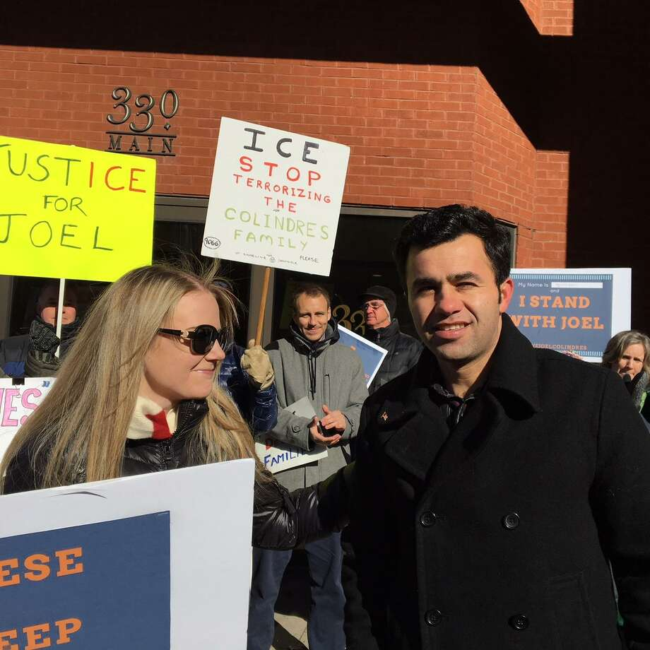 Samantha and Joel Colindres at a rally in Hartford where supporters back his attempt to get a court hearing on his asylum petition. Photo: Mary E. O'Leary / Hearst Connecticut Media