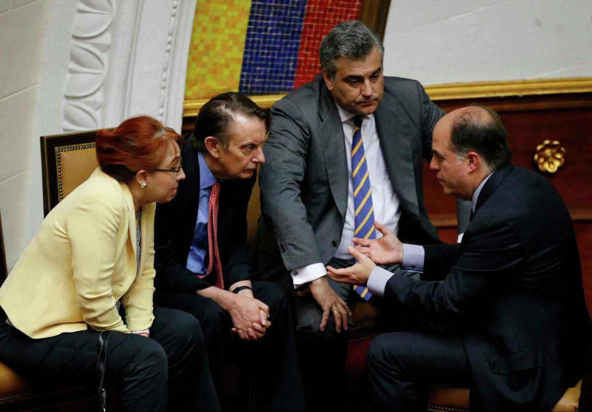 FILE - In this Aug. 1, 2017 file photo, Venezuela's National Assembly President Julio Borges, right, speaks with Mexican Ambassador Sylvia Sevilla, from left, British Ambassador Nicolas Harrocks and Spanish Ambassador Jesus Silva, in Caracas, Venezuela. Venezuela's foreign minister said in a statement Thursday, Jan. 25, 2018, that it is stripping Silva of his diplomatic credentials, accusing the European country of meddling in its affairs. (AP Photo/Ariana Cubillos, File)