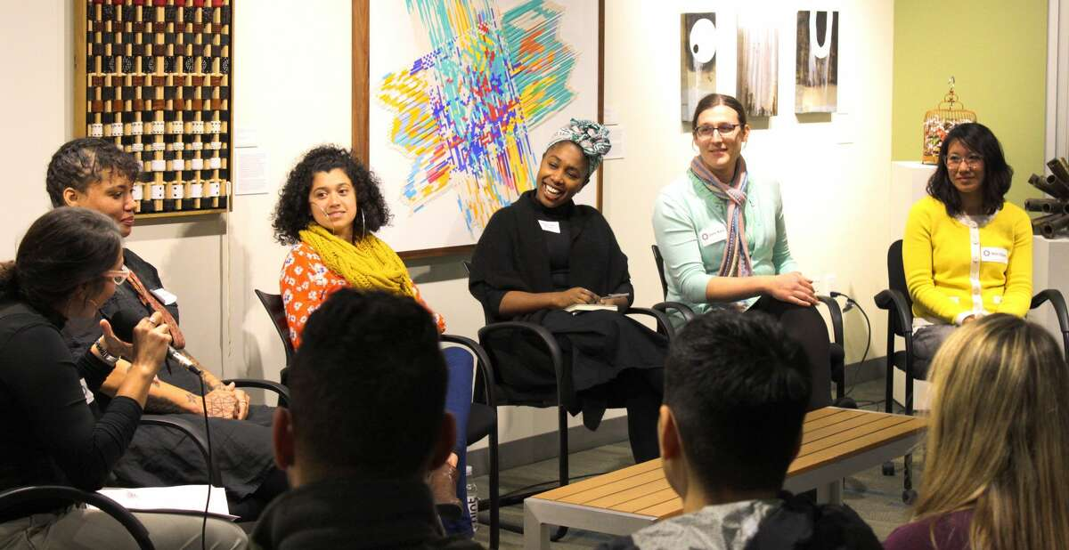 People attend a panel discussion on intersectional feminism and biking, hosted by the San Francisco Bicycle Coalition.