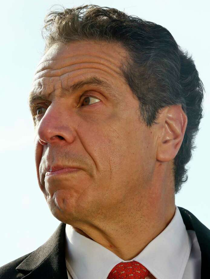 New York Gov. Andrew Cuomo listens during a press conference, Sunday Jan. 21, 2018, in New York. Cuomo says the Statue of Liberty and Ellis Island will be open for visitors on Monday, with New York state picking up the tab for federal workers. The two sites have been closed due to the federal government shutdown. (AP Photo/Bebeto Matthews) Photo: Bebeto Matthews, STF / Copyright 2018 The Associated Press. All rights reserved.