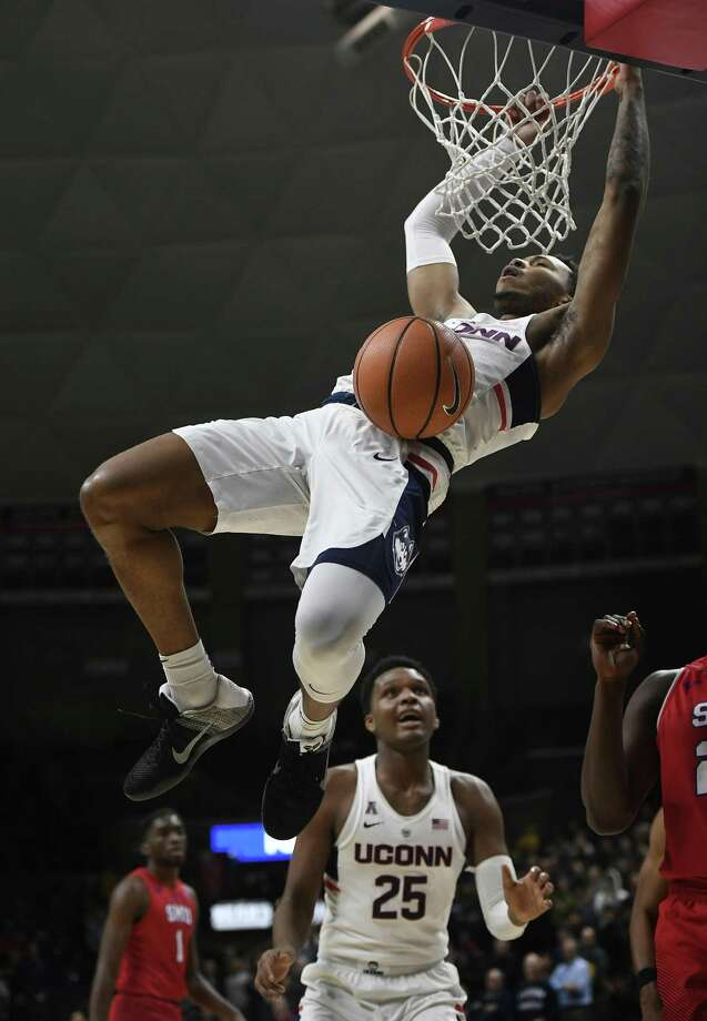 UConn's Jalen Adams dunks during the first half of a game against SMU on Thursday in Storrs. The Huskies won 63-52. Photo: Jessica Hill / AP / AP2018