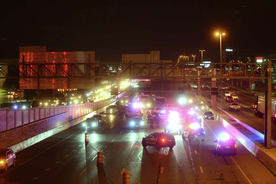 Loop 410 East is shut down at McCullough after a man was shot by police  on Thursday night, Jan. 25, 2018. Photo: Billy Calzada, San Antonio Express-News / San Antonio Express-News