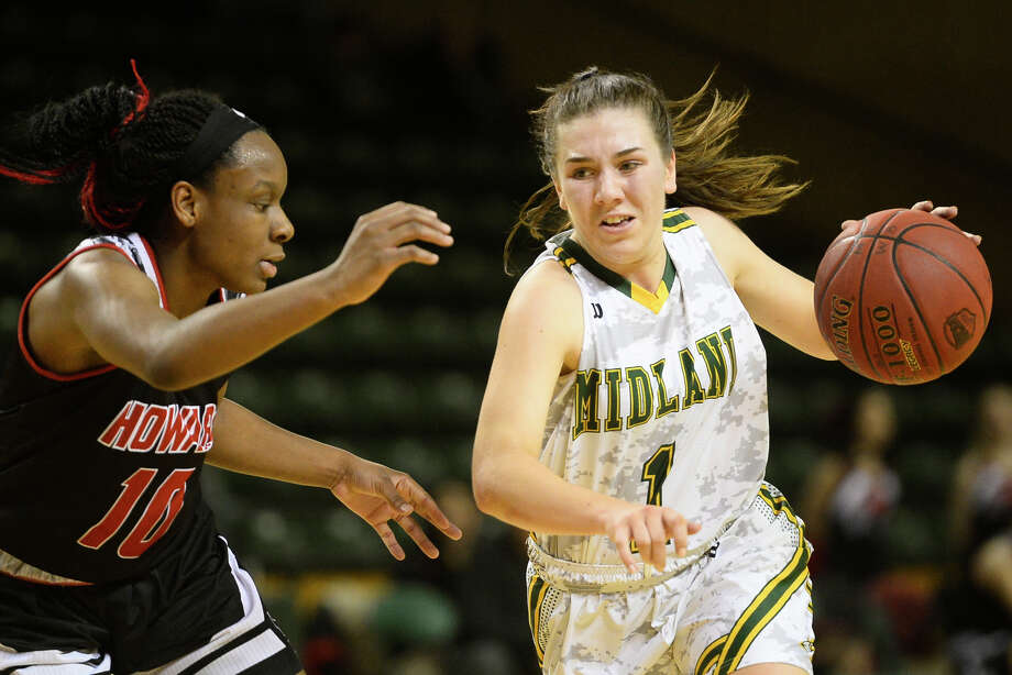 Midland College's Bethany Theodore (1) dribbles against Howard College's Cierra Morris (10) on Jan. 25, 2018, at Chaparral Center. James Durbin/Reporter-Telegram Photo: James Durbin