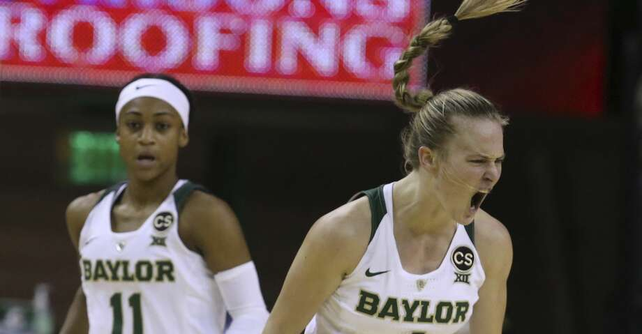 Baylor guard Kristy Wallace, right, reacts after scoring against Texas, next to guard Alexis Morris duringthe first half of an NCAA college basketball game, Thursday, Jan. 25, 2018, in Waco, Texas. (AP Photo/Rod Aydelotte) Photo: Rod Aydelotte/Associated Press