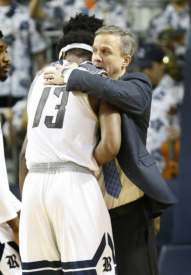 Rice Head Coach Scott Pera hugs Rice forward Malik Osborne after defeating Florida International in Tudor Field House Thursday, Jan. 25, 2018, in Houston. ( Steve Gonzales / Houston Chronicle ) Photo: Steve Gonzales/Houston Chronicle