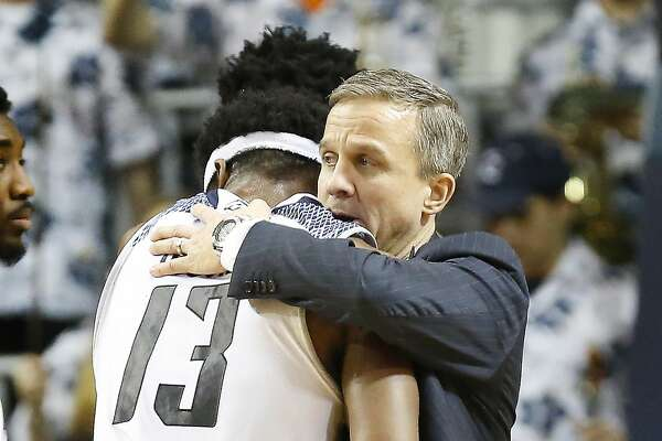 Rice Head Coach Scott Pera hugs Rice forward Malik Osborne after defeating Florida International in Tudor Field House Thursday, Jan. 25, 2018, in Houston. ( Steve Gonzales / Houston Chronicle )