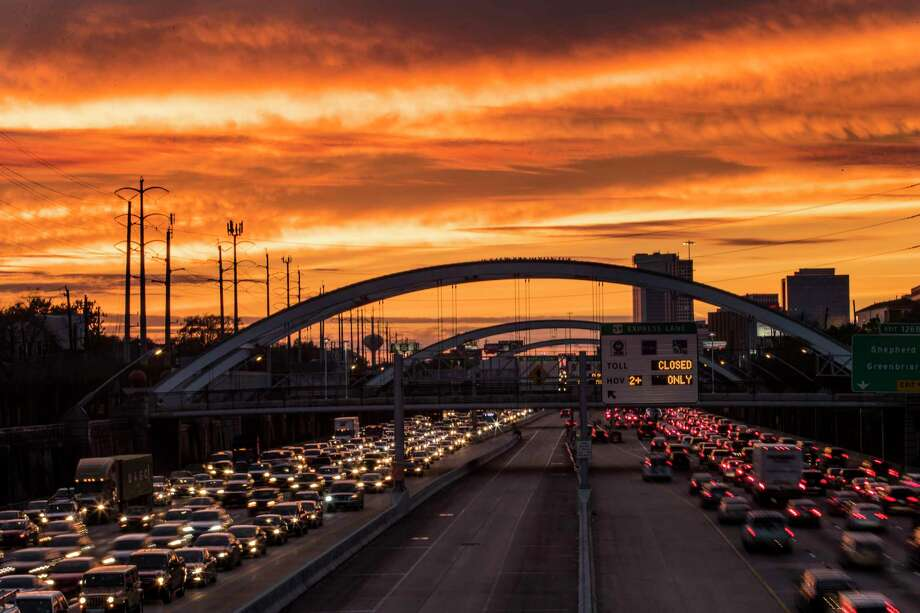 Commuters travel on U.S. 59, under bridges that were once lit up with colorful lights, as the sun sets on Thursday, Jan. 25, 2018, in Houston. The lights have been off the past several days because the Montrose Management District coiuldn't pay its bill. Photo: Brett Coomer, Houston Chronicle / © 2018 Houston Chronicle