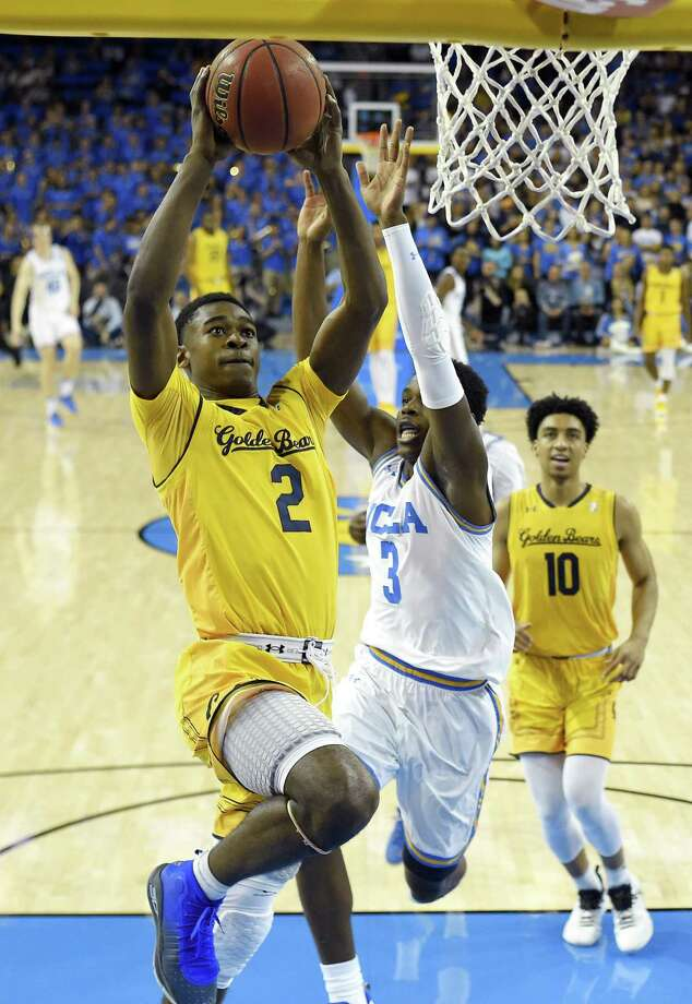 California guard Juhwan Harris-Dyson, left, shoots as UCLA guard Aaron Holiday, center, defends and California forward Justice Sueing watches during the first half of an NCAA college basketball game Thursday, Jan. 25, 2018, in Los Angeles. (AP Photo/Mark J. Terrill) Photo: Mark J. Terrill / AP / Copyright 2018 The Associated Press. All rights reserved.