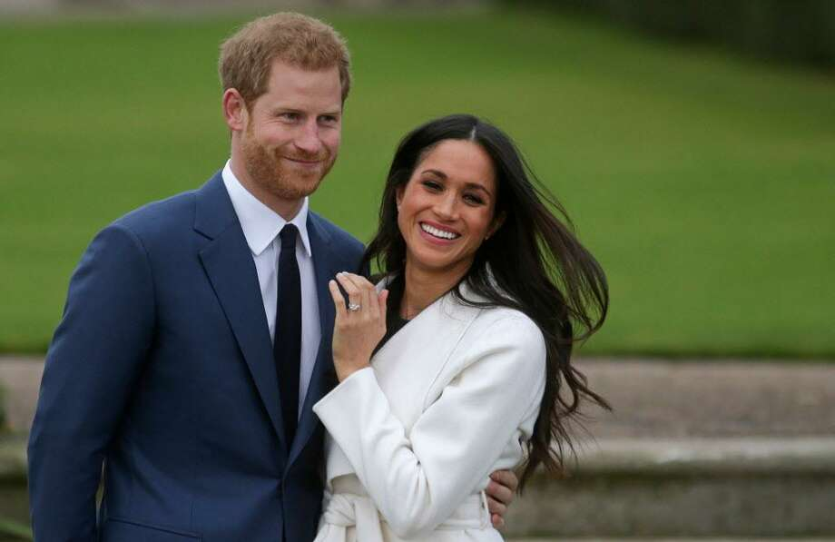 Britain's Prince Harry and U.S. actress Meghan Markle pose for photographs on Nov. 27 in the Sunken Garden at Kensington Palace in London, following their engagement announcement. As the wedding plans progress, such juicy tidbits as to what will be the flavor of their ceremonial cake are attracting the public's attention. Photo: Daniel Leal-Olivas / AFP / Getty Images / AFP or licensors