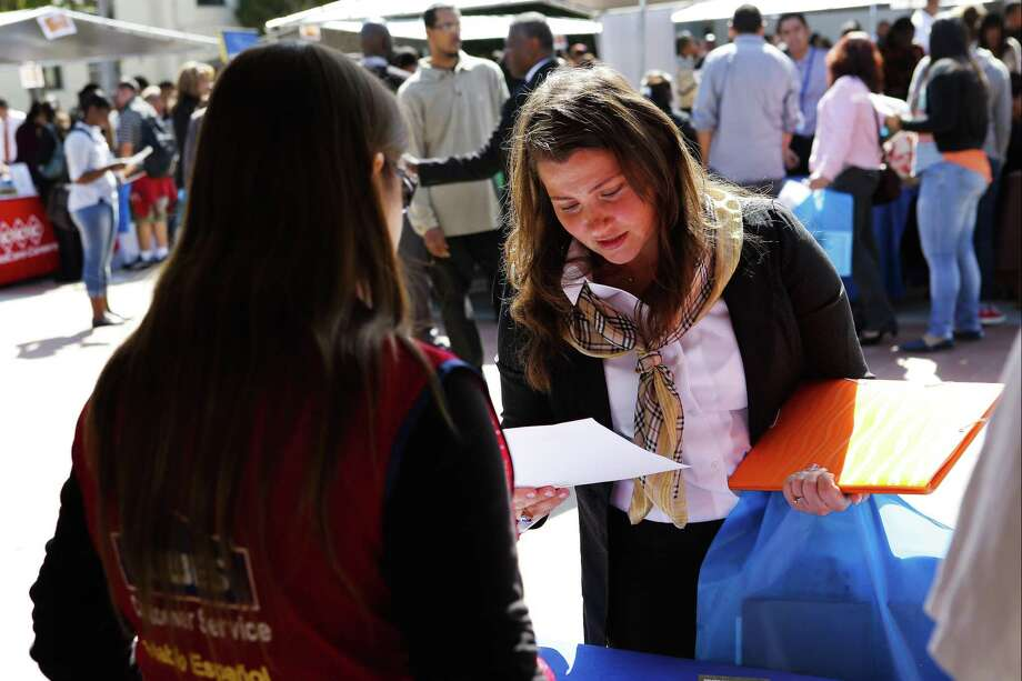 A prospective applicant gets information about Lowe's at a 2013 job fair in Los Angeles. Lowe's plans to hire 53,000 seasonal employees to work March-September 2018, with the company listing more than 100 openings in Connecticut as of late January. Photo: Patrick T. Fallon / Bloomberg / © 2013 Bloomberg Finance LP