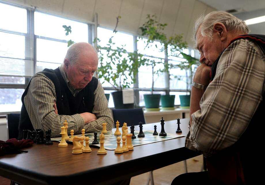 Frank DeStefano, left, of Fairfield, and Teo Perrini, of Shelton, play a game of chess as part of the Fairfield Senior Chess Club at the Bigelow Center for Senior Activities on Jan. 17. Photo: Brian A. Pounds / Hearst Connecticut Media / Connecticut Post