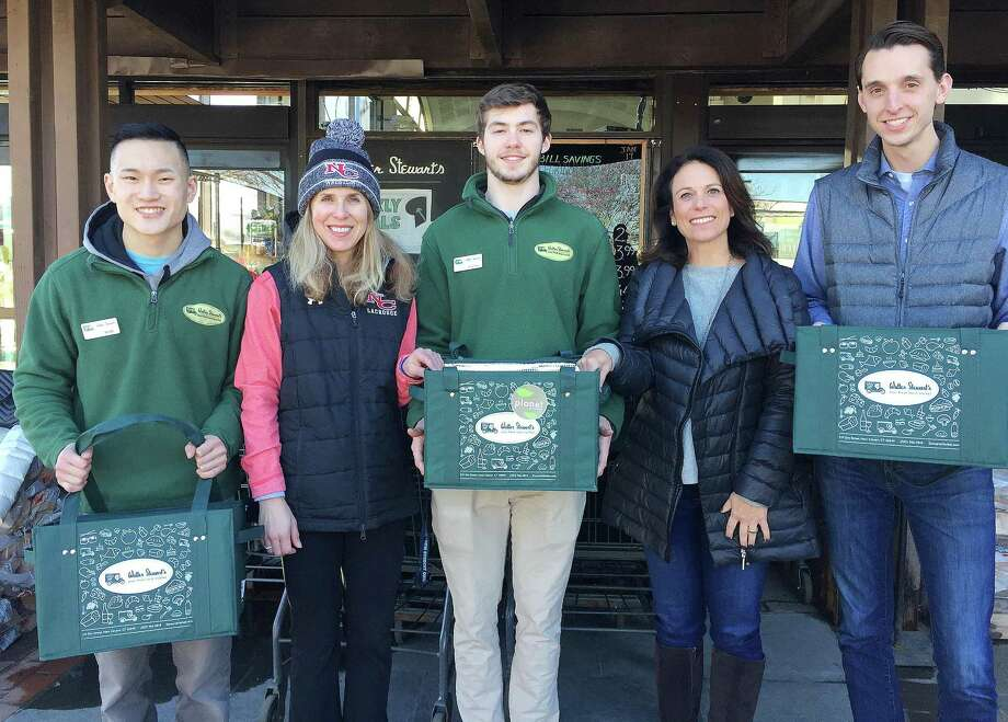 Stewart's Market and Planet New Canaan have teamed up to promote the use of reusable bags and support The New Canaan All Sports Booster Club. From left: Rob Zimmerman, Kathy Bucci, Justin Graff, Elissa Mellinger and CJ Heron. Photo: Contributed Photo / New Canaan News