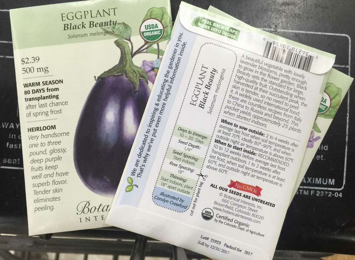 The back of the seed packets describes everything needed to grow them - from spacing and soil depth to light conditions and moisture requirements.