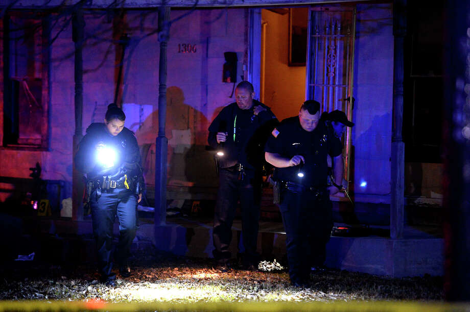 Port Arthur police investigate a shooting in the 1300 block of Trinity Ave. on Thursday night. A department spokesperson said two people were shot in the back of the head; one died at the scene. Photo taken Thursday 1/25/18 Ryan Pelham/The Enterprise Photo: Ryan Pelham/Ryan Pelham/The Enterprise