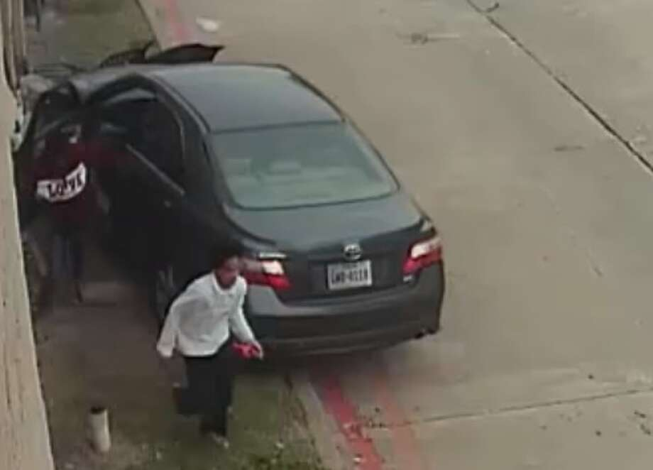Houston police are searching for four young suspects who allegedly carjacked a pregnant woman, then later crashed her car at an apartment complex before fleeing the scene. The carjacking occurred on Dec. 14, 2017, and the crash depicted in these surveillance images occurred the next day, police said. Photo: Houston Police Department Robbery Division