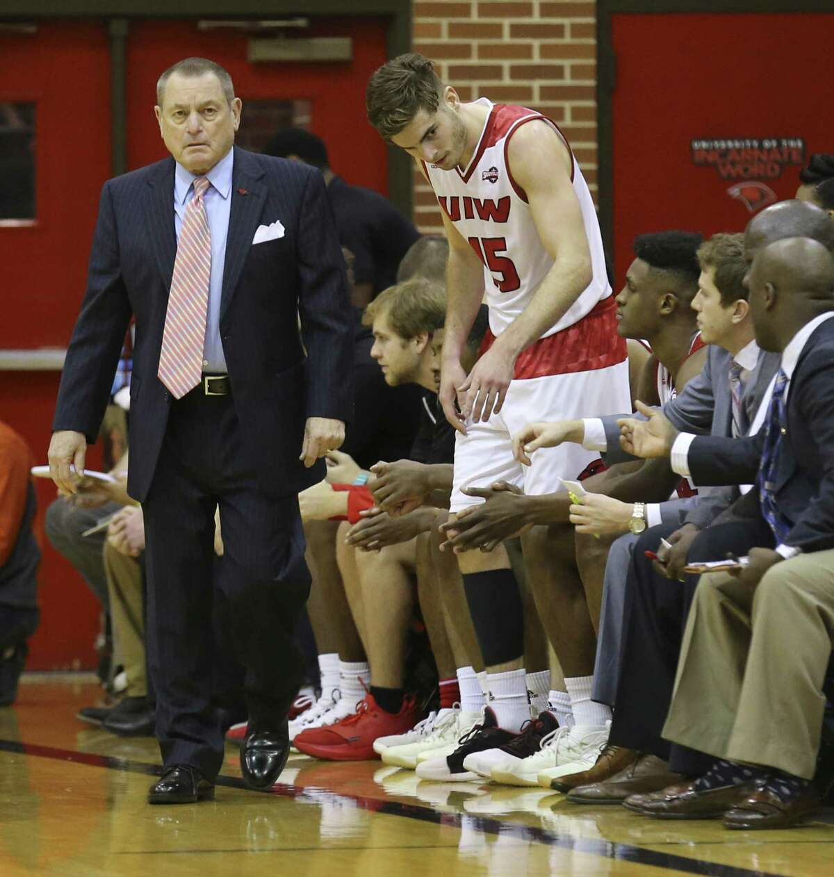 Profile on UIW basketball player Sam Burmeister who was heading to the bench beside his father, Ken Burmeister, who is the head coach of the basketball team during the Cardinals game against University of Missouri-Kansas City at McDermott Center on Saturday, Dec. 16, 2017.