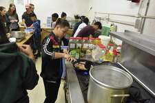 Albany Medical Center students prepare breakfast for dinner with kids from the Refugee and Immigrant Support Services of Emmaus during Cooks for a Cause on Jan. 23, 2018. (Massarah Mikati/Times Union)