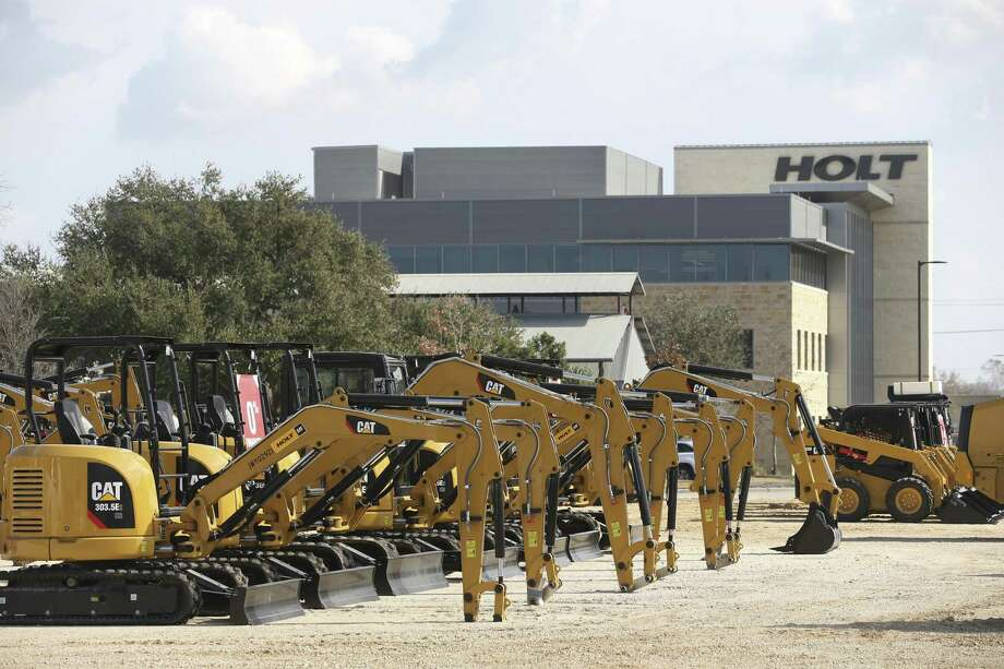 Caterpillar machines line a lot at Holt Cat's San Antonio headquarters complex. The company said optimism has been voiced by companies it does business with. Photo: JERRY LARA /San Antonio Express-News / © 2018 San Antonio Express-News